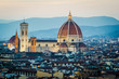 Florence, Tuscany, Italy. Cytiscape with the Cathedral and the Brunelleschi Dome, Giotto Tower at sunset, lights on.