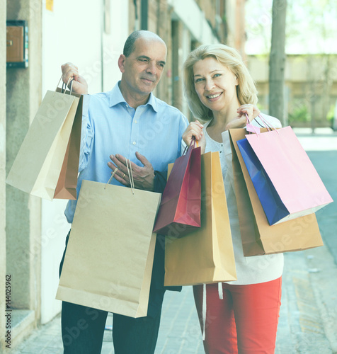 Foto op Plexiglas Art Studio Positive mature family with bags after shopping