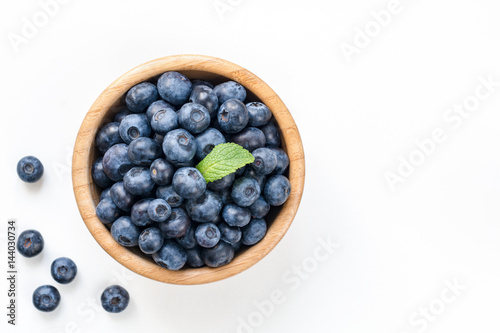 Stampa su Tela Bowl of fresh blueberries isolated on white, top view copy space