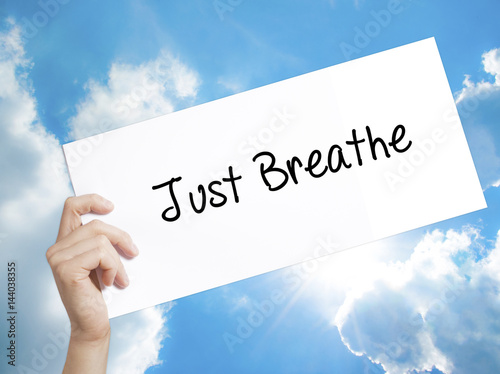 Photo  Just Breathe Sign on white paper