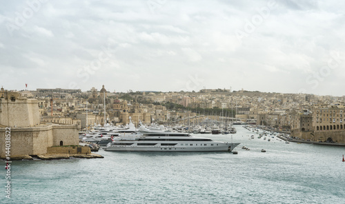 Photo  Luxury super yachts moored at Manoel Island, Malta