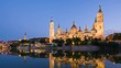 Zoom out timelapse of Zaragoza in a summer sunset