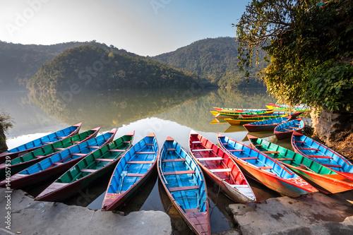 Foto op Canvas Nepal Colorful boats in Phewa lake in Pokhara, Nepal