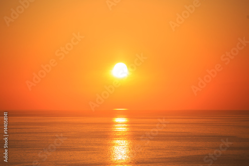 Photo Stands Cuban Red Beautiful sunset with reflection on the sea