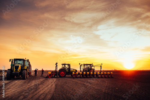 Foto  Agricultural mechanization on sunset