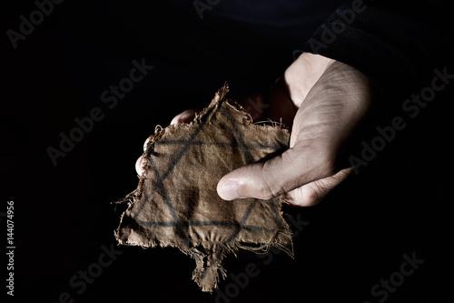 Fotografia, Obraz man with a ragged Jewish badge