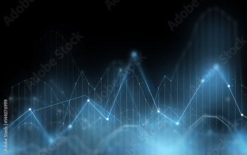 Fotografía  virtual chart projection over dark background