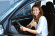 Cheerful mature woman in a car