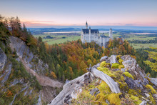 Sunset On Neuschwanstein Castle Surrounded By Colorful Woods In Autumn, Fussen, Bavaria, Germany