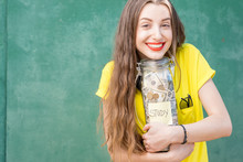 Young And Happy Woman In Yello...
