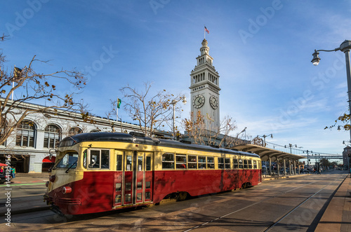 Spoed Foto op Canvas San Francisco Street car or trollley or muni tram in front of San Francisco Ferry Building in Embarcadero - San Francisco, California, USA