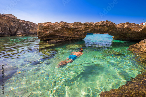 Blue Lagoon Malta Snorkeling Tourist At The Caves Of The