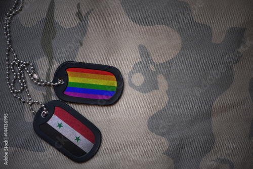 Stampe  army blank, dog tag with flag of syria and gay rainbow flag on the khaki texture background