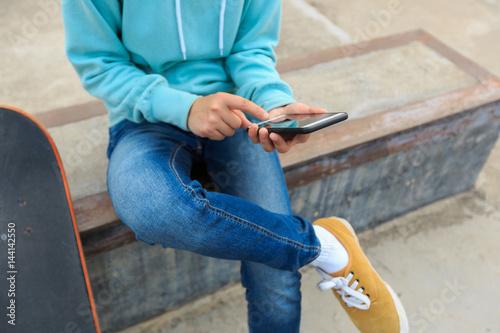 Fototapeta Young skateboarder riding skateboard obraz na płótnie
