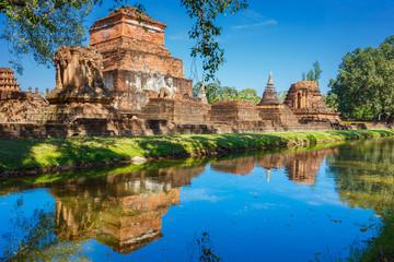 Fototapeta na wymiar Wat Mahathat Temple in the precinct of Sukhothai Historical Park, a UNESCO world heritage site in Thailand