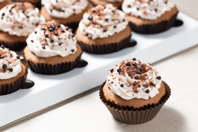 Coffee Cupcakes With Mocha Buttercream And Chocolate Decorations