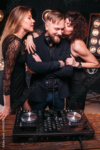 Two Beautiful Sexy Girls Flirt With Handsome Bearded Disk Jockey At Nightclub Party Nightlife Music Lifestyle Playful Clubbing People Relax Buy This Stock Photo And Explore Similar Images At Adobe Stock