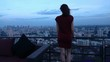 Elegant, pensive woman admire view standing on terrace in evening, super slow motion 240fps