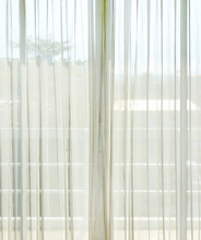 Close Up Of A White Net Curtain In Detail