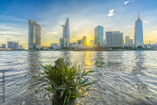 Foto  Ho Chi Minh City, Vietnam - March 25th, 2017: Riverside City sunset clouds in th