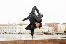 Young Stylish Man In Black Clothes Dancing In City