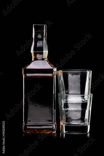 Bottle of whiskey and two empty glasses Canvas Print