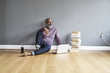 Mature man sitting on floor, using laptop