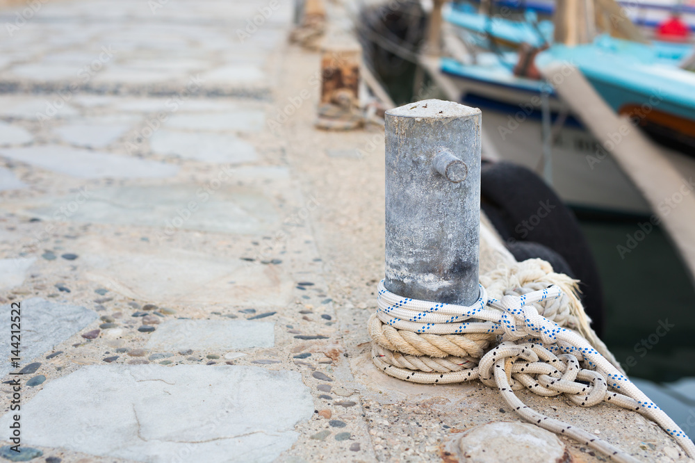 Photo & Art Print Wooden post with mooring ropes for tying