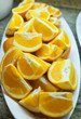 Vertical shot of breakfast plate with plenty of oranges cut in large chunks