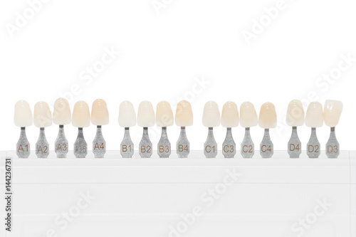 Palette of shades of teeth isolated on white - Buy this stock photo
