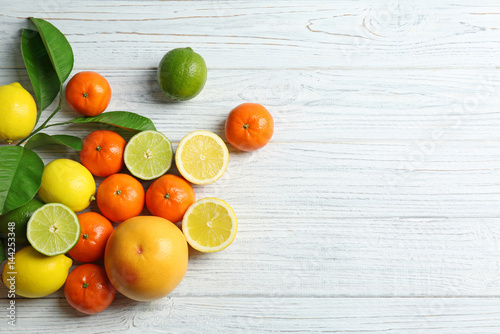 Poster Fruit Beautiful composition of tropical fruits on wooden background