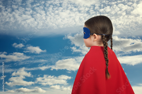 Photo  Cute little super hero girl in the red cloak. Superhero concept