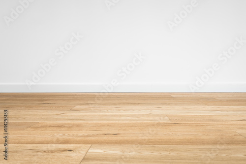 Photo new wooden floor  - parquet floor and white wall background