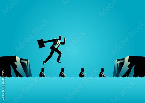 Fototapeta  Businessman using his friends as stepping stones