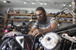 Mechanic repairing motorbike in garage
