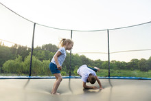 Children Jumping On A Trampoli...