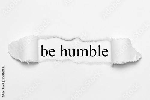 Photo  be humble on white torn paper