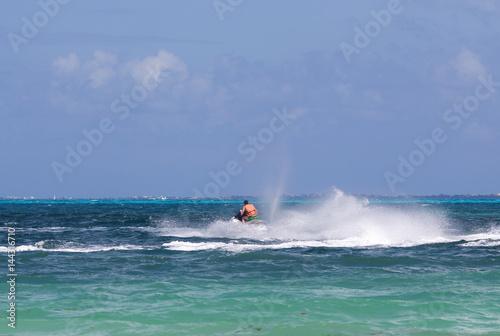 Garden Poster Water Motor sports Man driving a jet ski. Water splashing.