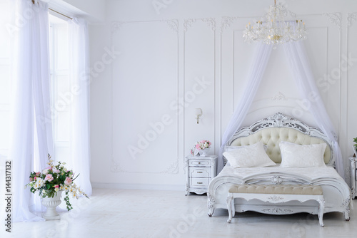 Fotografiet  Interior white bedroom with canopy