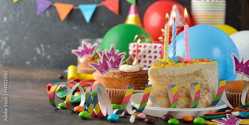 Photo  Birthday cake and various accessories for the holiday