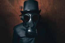 Man In Gas Mask With Black Hat