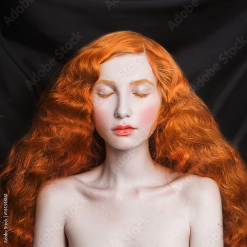 Woman With Long Curly Red Flowing Hair On A Black Background Red