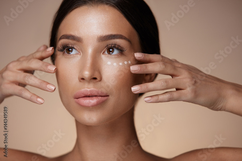 Obraz Woman With Smooth Soft Skin And Concealer Under Eyes. Cosmetics - fototapety do salonu
