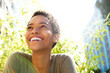 beautiful young black woman smiling outdoors