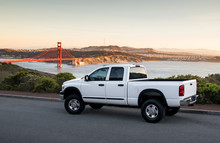 White Truck In Front Of The Golden Gate Bridge