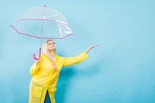 Woman Wearing Raincoat Holding...