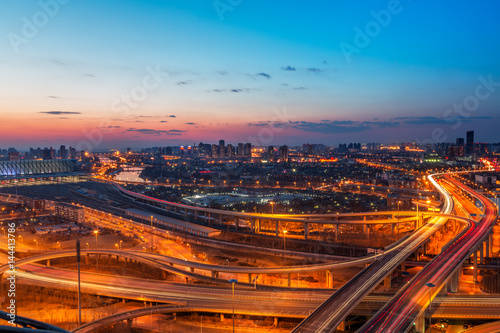 Poster Bangkok panoramic view of Shanghai overpass,road intersection at night in China.
