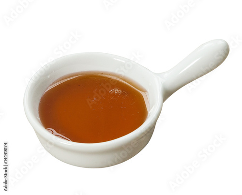 Canvas Prints Tea Small pot of honey. Isolated on white background