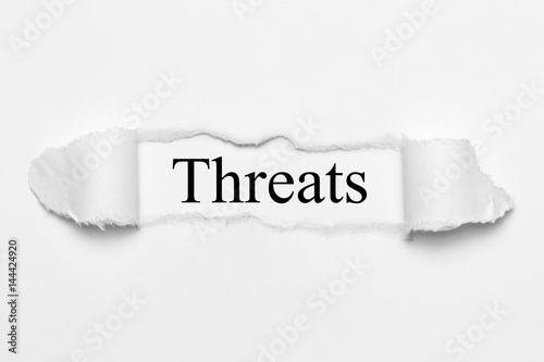 Fotografía  Threats on white torn paper