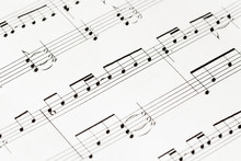 Music-notes On White Paper Macro
